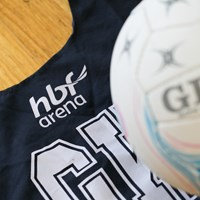 Netball bibs and ball at HBF Arena flat lay