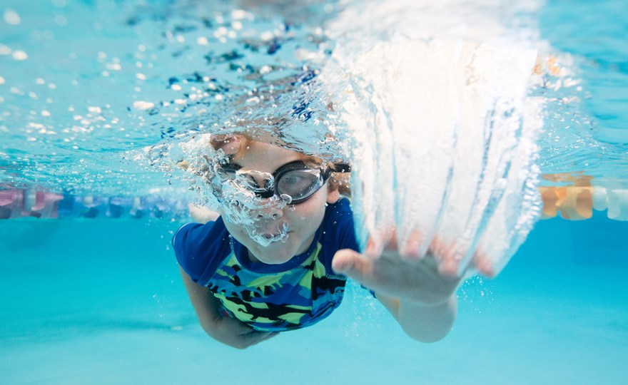 Boy swimming underwater at HBF Arena