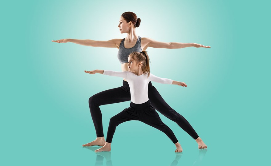 Mother and daughter demonstrating yoga position
